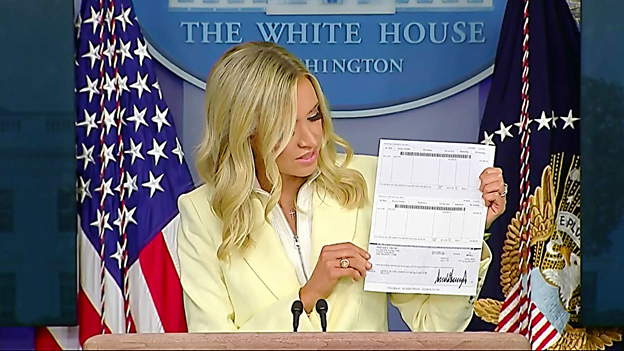 At press briefing, McEnany displays $100,000 check Pres Trump donating from his presidential salary to @HHSGov for development of medications to prevent and treat Coronavirus.