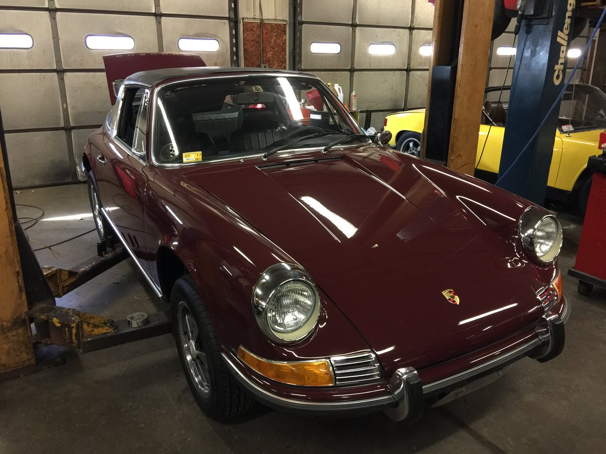 The fluorescent light in the shop makes the Color Code 2410 Burgandy (yes, it's spelled that way on the Porsche COA) glow. This color is original, as is the black interior. I restored it over a few years from an ill-advised Polo Red overspray.