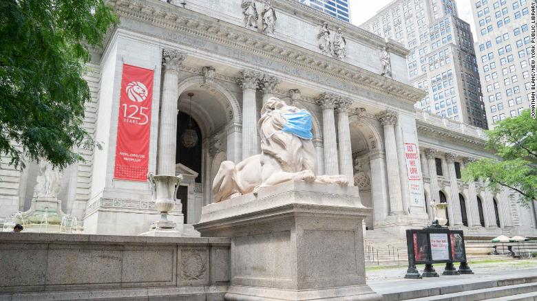 The iconic lion statues outside the New York Public Library are wearing face masks to encourage humans to do the same