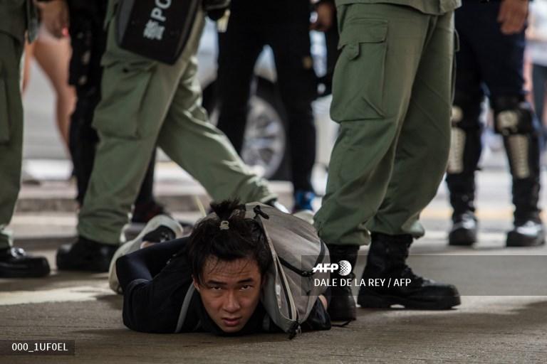 Hong Kong makes first security law arrests as thousands defy protest ban #AFP  📸 Dale De La Rey