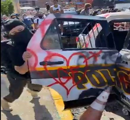 DAAT detectives seek the public's assistance to identify the two individuals in this series of photos.  Both are suspects in the vandalization of a marked police vehicle during the May 30 protests.  Info: Call 412-323-7800 and ask for the task force or email DAAT@pittsburghpa.gov