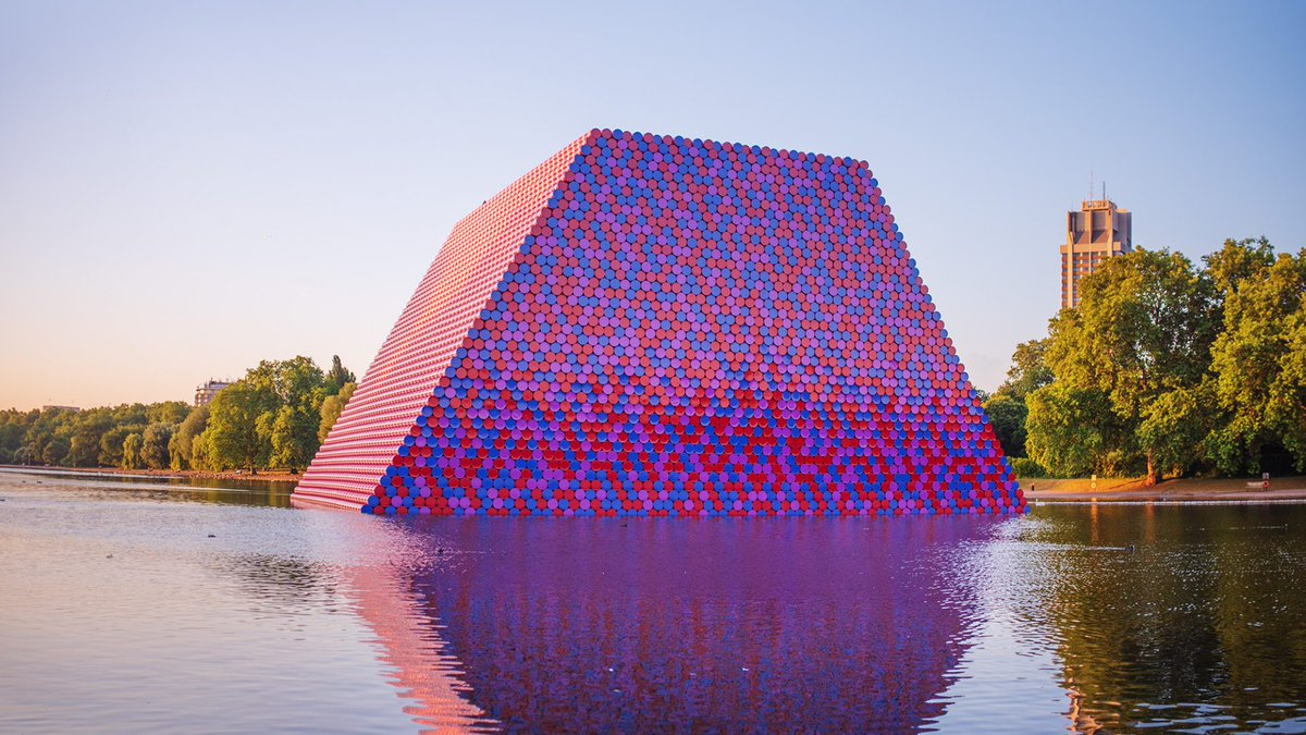 """The mastaba is an extraordinary form… It's a movement, a burst of strength."" Christo and Jeanne-Claude's sculpture 'The London Mastaba' was made of 7,506 colourful stacked barrels.  Explore 50 years of @serpentineUK's artists, projects and exhibitions:"