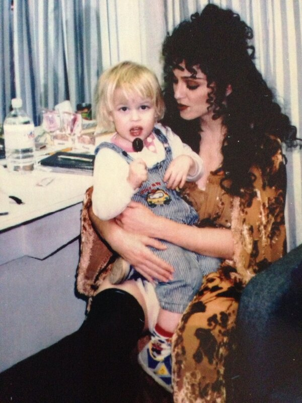 Happy Pride. Here I am sitting on Madonna's lap, being not straight.