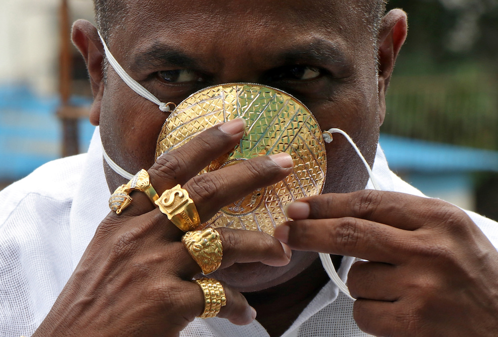 #PHOTOS: 'No expense spared'...  Man pays $4,000 for bespoke gold face mask to protect him from #Coronavirus raging in #India