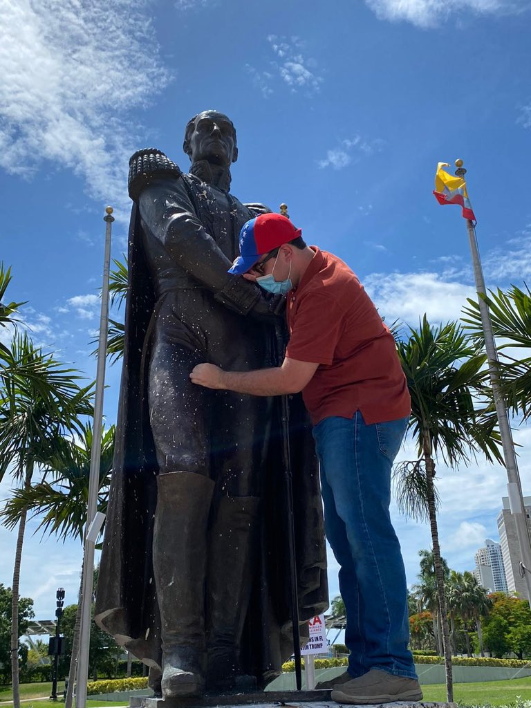 """Ignorant Leftists attacked Miami's Simón Bolívar monument.  Bolivar, known as """"The Great Liberator,"""" freed much of LatAm from Spanish colonialism.   Thankfully, a group of Venezuelan American patriots are spending their Sunday morning repairing what Marxists tried to destroy."""