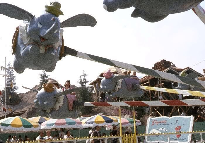 Disneyland's Dumbo in 1956, with the Fantasyland Skyway chalet under construction in the background. https://t.co/4ykqgcoj2r