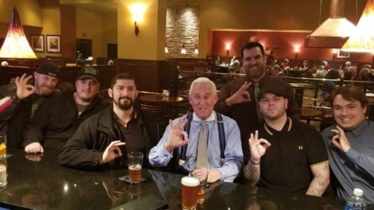 "Here's Roger Stone with the white supremacy group Proud Boys. This is who Trump protects. Y'all know that is a ""white power"" symbol, right?"