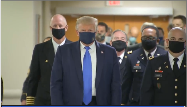 For the first time since the coronavirus pandemic began, President Trump has been seen by the White House press corps wearing a mask. Today, he's sporting the face covering while visiting wounded troops at Walter Reed Medical Center.