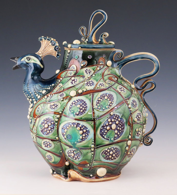Peacock teapot by Carol Long, US ceramicist who draws influences from plant and animal life #womensart