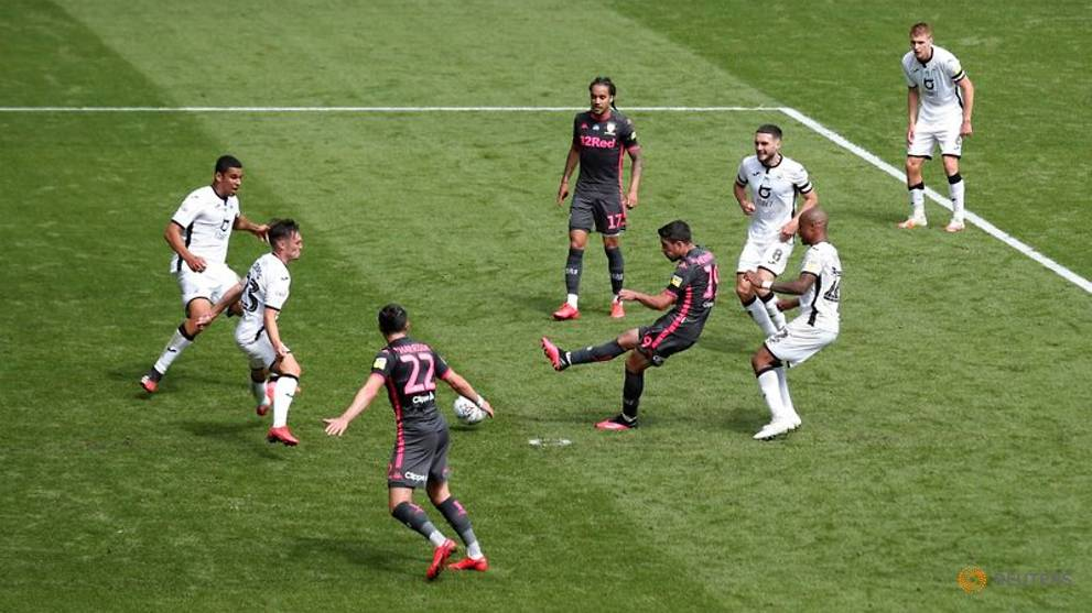 Football: Leeds strike late to sink Swansea, take three-point lead in Championship
