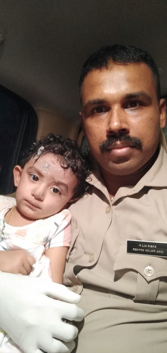 The child in the photo was found alone at the accident site. She's being taken to the Kondotty hospital. If anyone knows her, please contact 9048769169.   Please share.  #planecrash #AirIndia