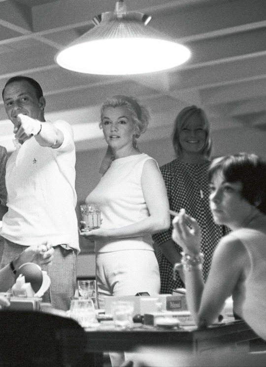 Marilyn Monroe and Frank Sinatra onboard Dean Martin's yacht photographed by Bernie Abramson, 1960. https://t.co/l1l4uPKteb