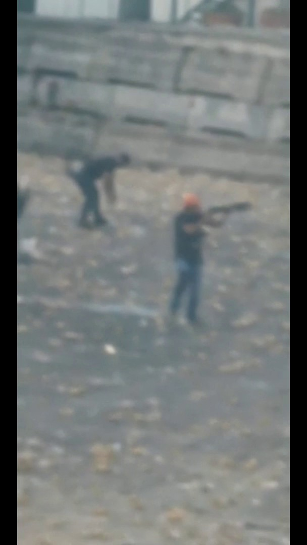Who are the armed men in civilian clothes mixed in with the uniformed military and firing live ammunition at the Lebanese demonstrators?