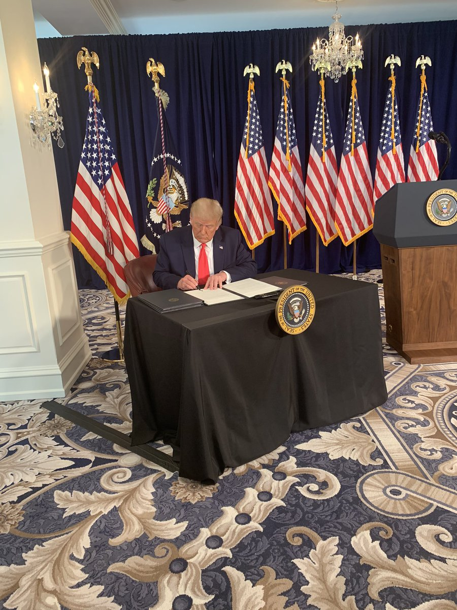 There were four pens out but he signed all the executive orders with the same one.