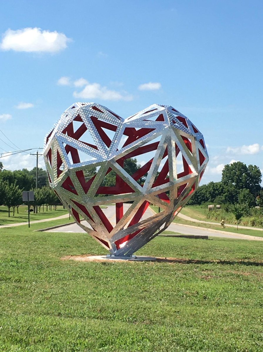 We are in love with Bentonville's newest piece of public art! Ride over to the roundabout at the intersection of Bright Rd and Gator Blvd near Willowbrook, Bight Field, and Fullbright to see it for yourself!  #visitbentonville #bikebentonville #bikesandart #bentonvillear