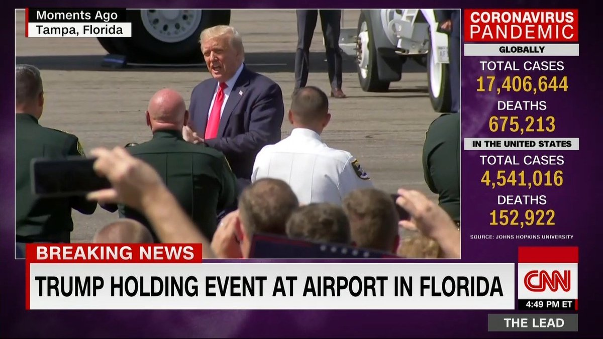 Trump holds event with Florida supporters at Tampa airport, with little distancing or mask-wearing @ryanobles reports