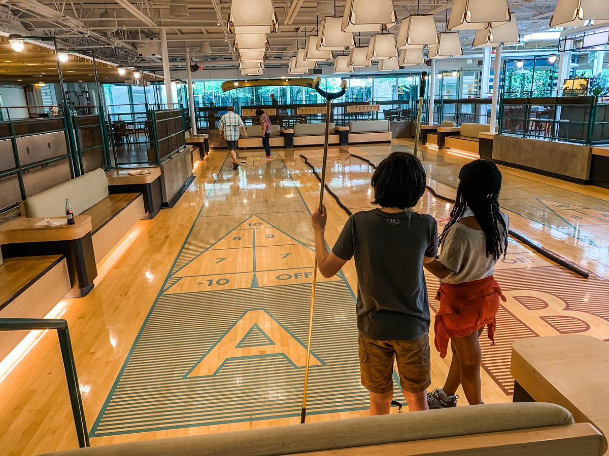 Weekends are for the family. Head over to 8th Street Market and join in on the shuffleboard fun at The Holler!   #visitbentonville #bentonvillear