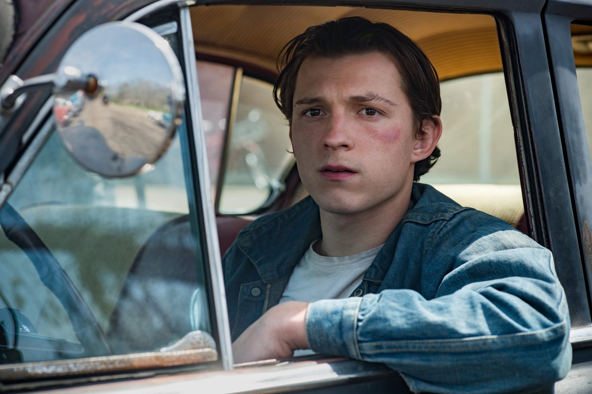 Here's your first look at THE DEVIL ALL THE TIME, a midwestern gothic tale from Antonio Campos starring Tom Holland, Robert Pattinson, Jason Clark, Riley Keough, Bill Skarsgård, Sebastian Stan, Haley Bennett, Mia Wasikowska, and Eliza Scanlen.  On Netflix globally on 16 Sept.