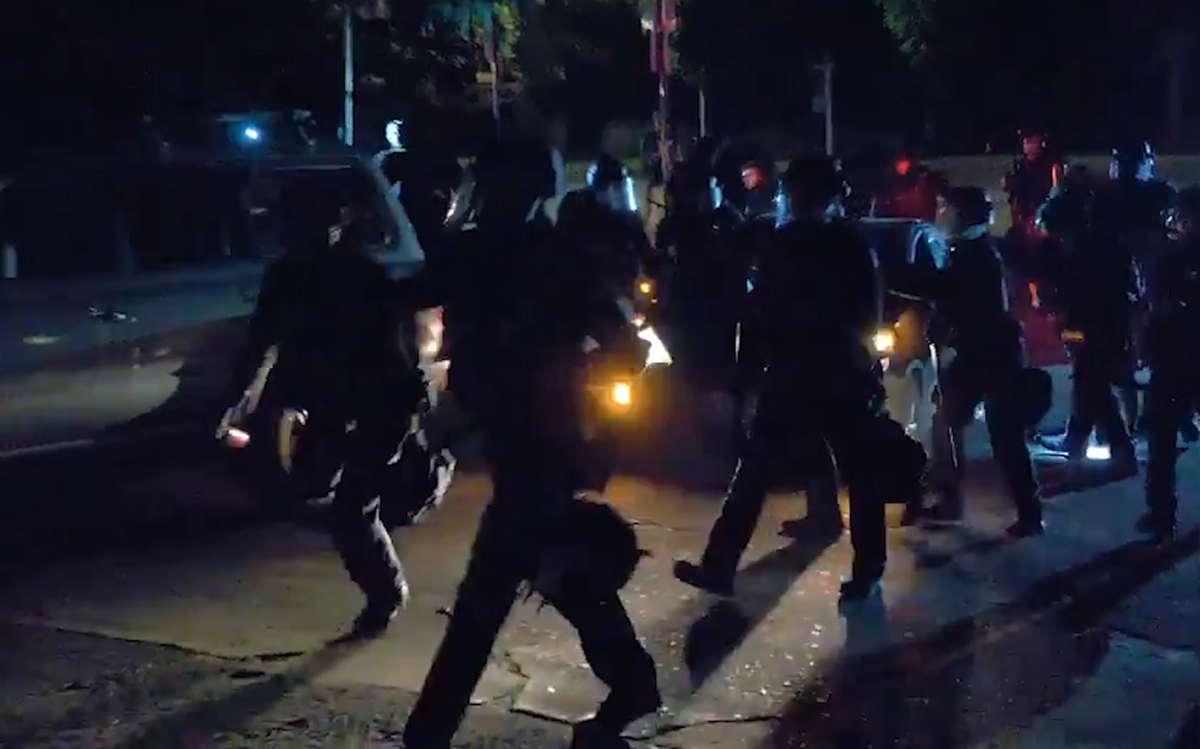 Portland police smash window, slash tires of woman's Prius during protest dustup (video)