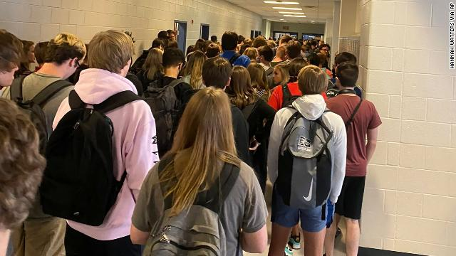 The Georgia student who shared a photo of a crowded hallway at her high school says she has received threats. The school will temporarily switch to virtual learning after nine people tested positive for coronavirus.