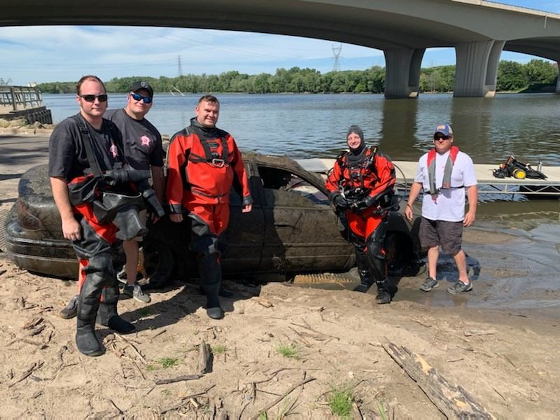 The DCSO Dive Team recovered a vehicle from the Mississippi River in South St. Paul. We were notified earlier this summer of this vehicle. With the low current and wind we were able to recover it.  We located two different V.I.N. numbers on it and are still working on that info.