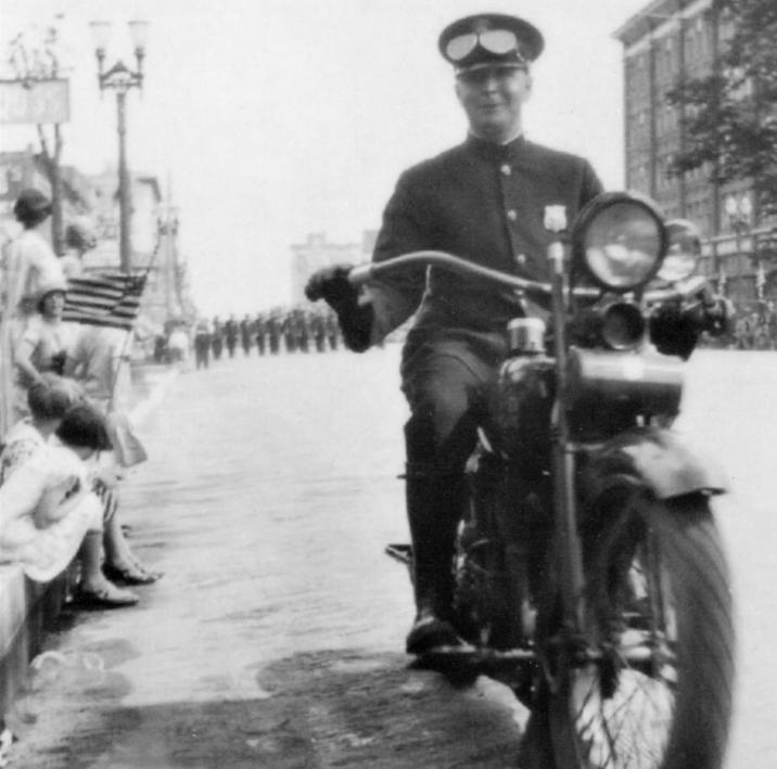 Circa 1920's - Lansing Police Department Motor Officer leading a parade in Lansing, MI #TBThursday