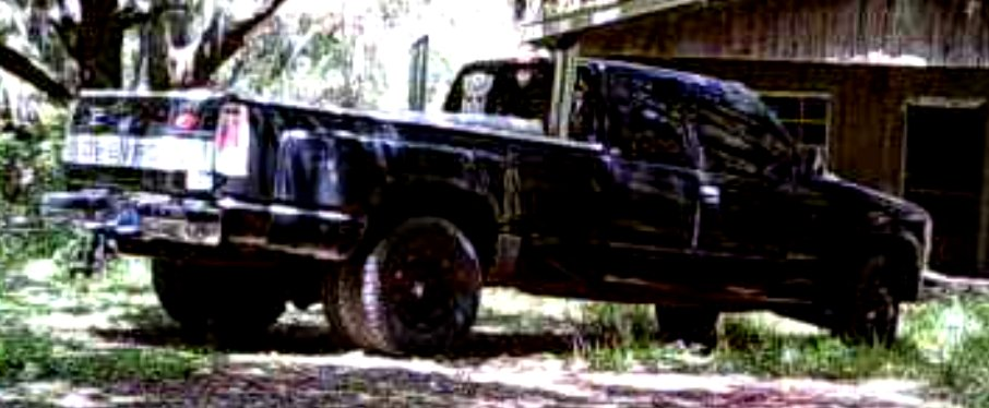 Attempting to identify the driver of this blue Chevy pick-up w/ large smokestacks, white Transformer's movie (Autobots) decal on the driver side rear window, Superman (S) decal on the rear window in the center & another unknown decal. Driver possibly witnessed crime in progress.