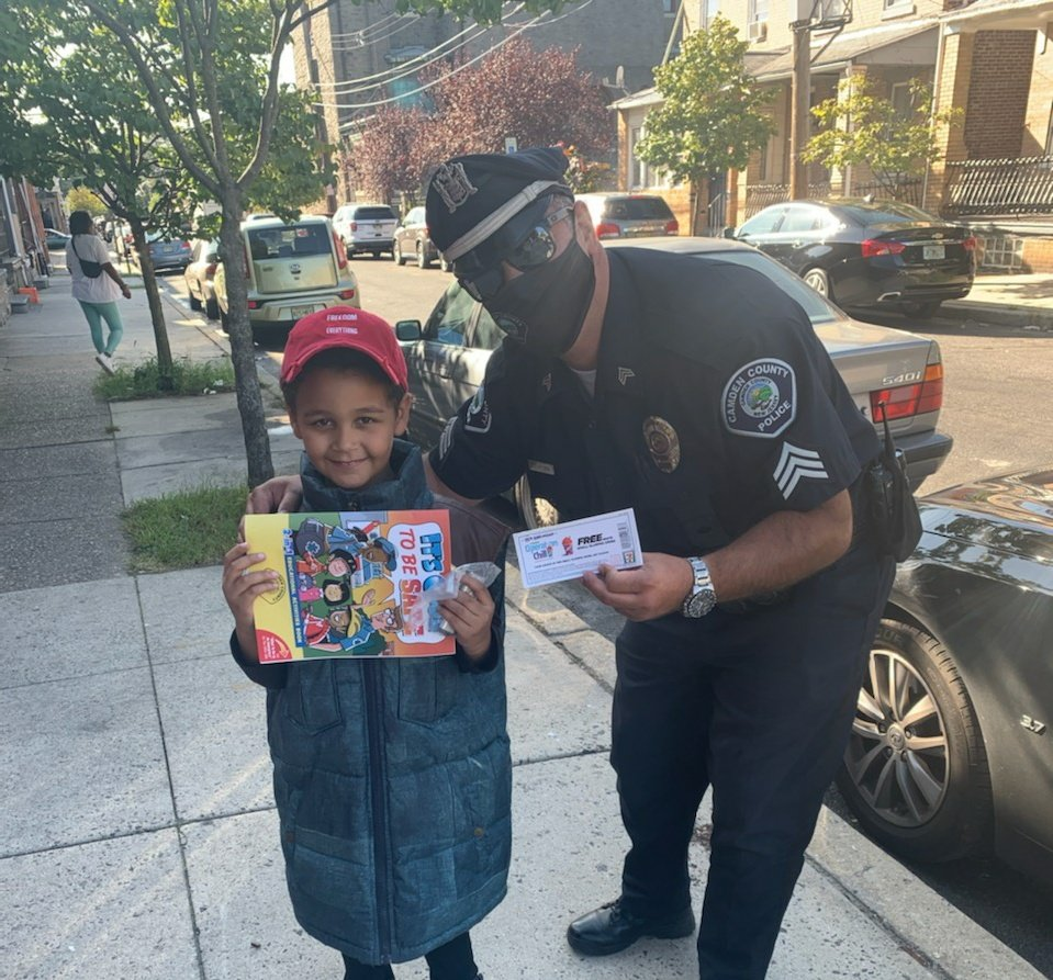 Sergeant Levy on Mechanic Street handing out a