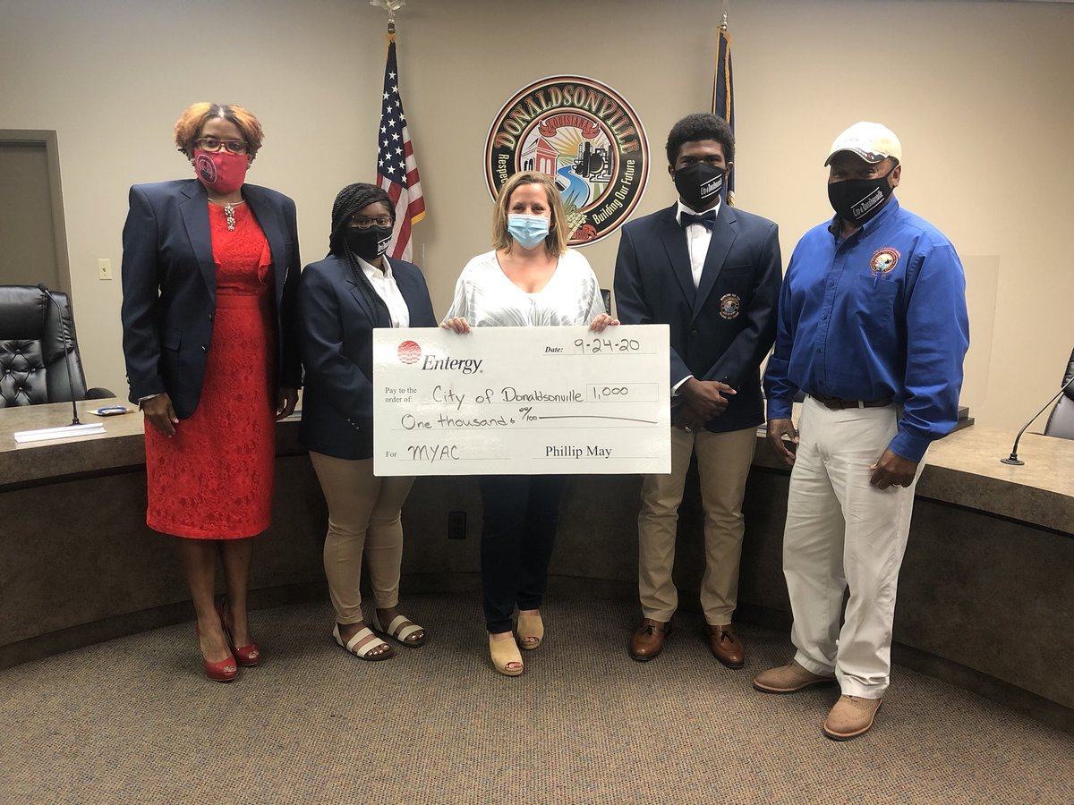 Entergy's Deanna Lafont presented a $1,000 donation to the sixth class of the Mayor's Youth Advisory Council at City Hall. Shown, from left, are: Volunteer Coordinator Tamiko Francis Garrison, 1st Vice Pres. Laila Cost, Lafont, Pres. Joel Walker, and Mayor Leroy Sullivan.