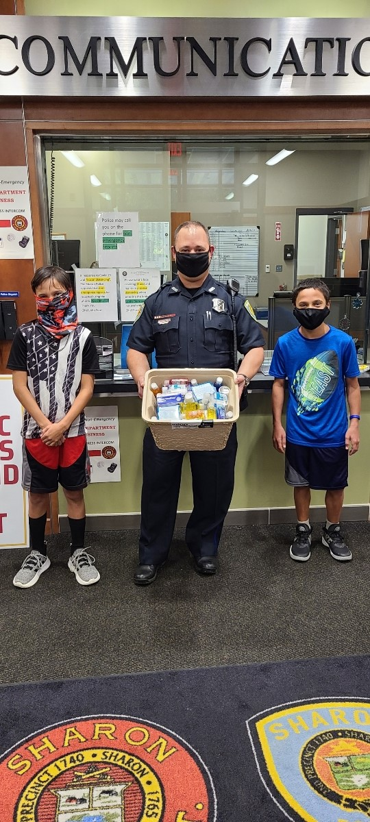 Kindness shared: Max and Mitchell raised money so they could donate face masks, hand sanitizers and gloves to SPD. They also shared some candy. Officer Kraus gave them a tour of the station to thank them for their kindness. #kindnesssharonma #sharonpolicecommunitypolicing