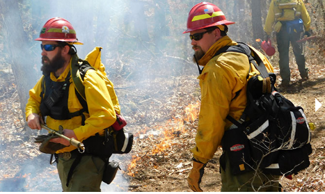 DEM Warns Rhode Islanders of Extreme Fire Danger    📷- DEM firefighters Olney Knight and Greg Rathbun at a prescribed burn in Charlestown in 2018.