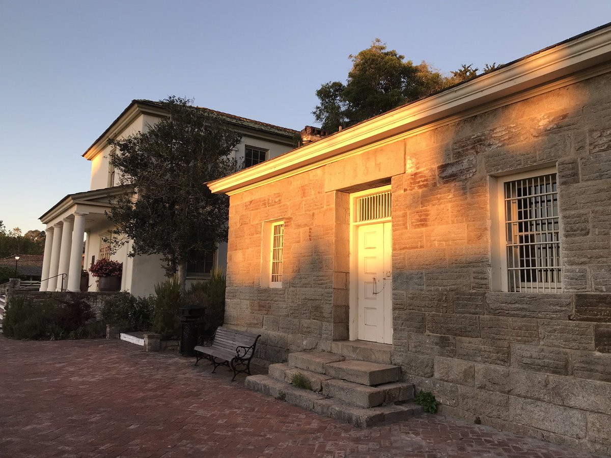 """Sunrise hits the Old Monterey Jail, built in 1854. It's going to be another beautiful day at #Monterey City Hall. Learn more about this historic and """"impenetrable fortress"""" in today's #FlashbackFriday video:  #Monterey250 #FBF"""