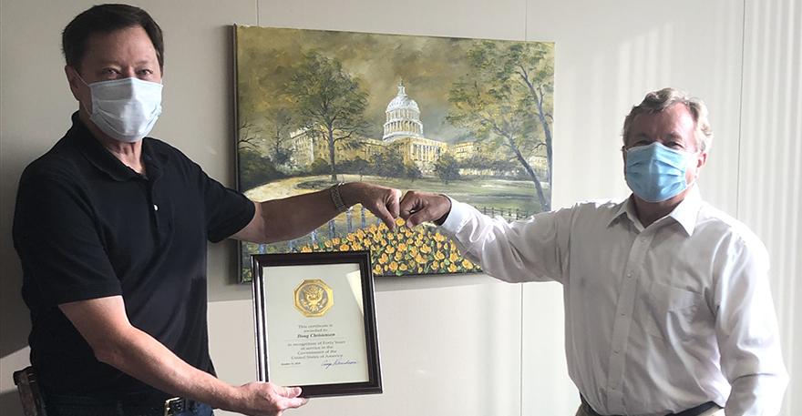 Nebraska State Conservationist @craigderickson congratulates Doug Christensen for 40 years, and Jamie Petersen for 15 years of public service @NebraskaNRCS