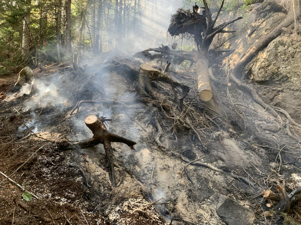 With little to no rain in the forecast, we need to be extra careful with open fires, especially campfires!  📷 A ground fire smolders after a campfire was improperly extinguished