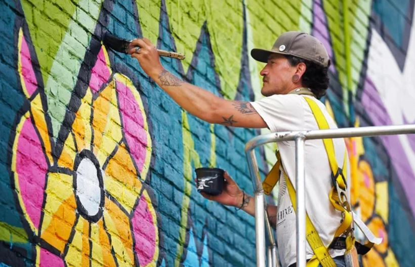 A newly finished tree mural by Akron artist Matt Miller outside Hazel Tree Design Studio is a love letter to Akron's West Hill neighborhood, with the words
