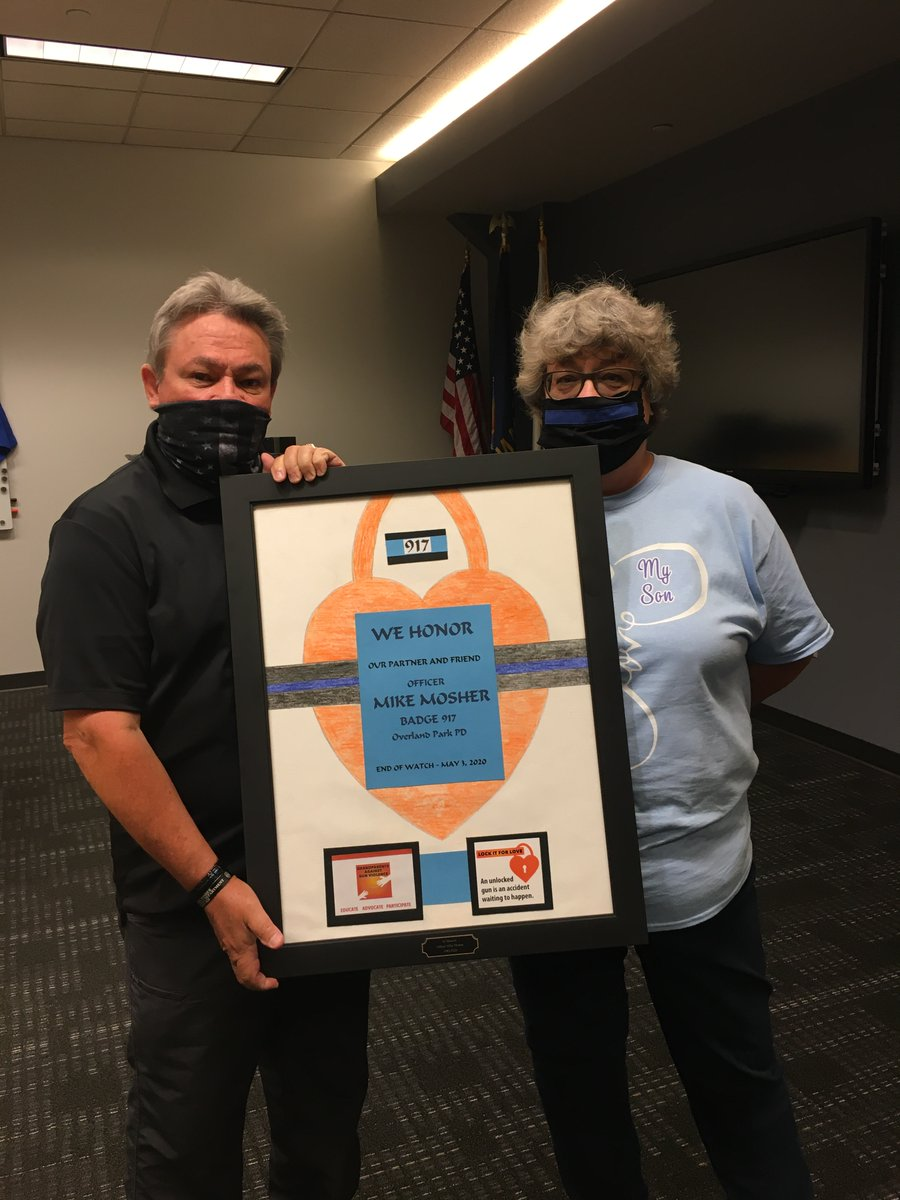 The parents of Fallen Officer Mike Mosher receives a gift from Grandparents Against Gun Violence.  Officer Mosher was very active with this organization to improve gun safety in Overland Park. #BELIKEMIKE