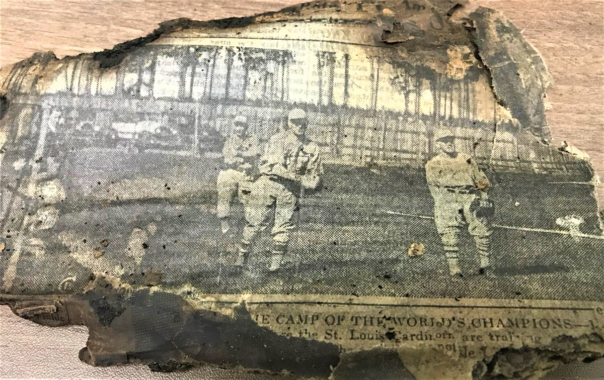 During water main repairs at S. Pearl & Old S. Pearl in #Albany, we found some old, burnt newspaper from 1926! The photo shows the @Cardinals - the World Series Champions from that year.