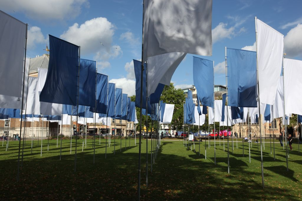 Wonderful to see @lukejerram's #InMemoriam in the sunshine today. Over 100 flags made of NHS bedsheets acting as a powerful memorial and tribute to health & care workers.   #NHS #LoveBristol #LoveTheNHS https://t.co/lPUdWTFPbb