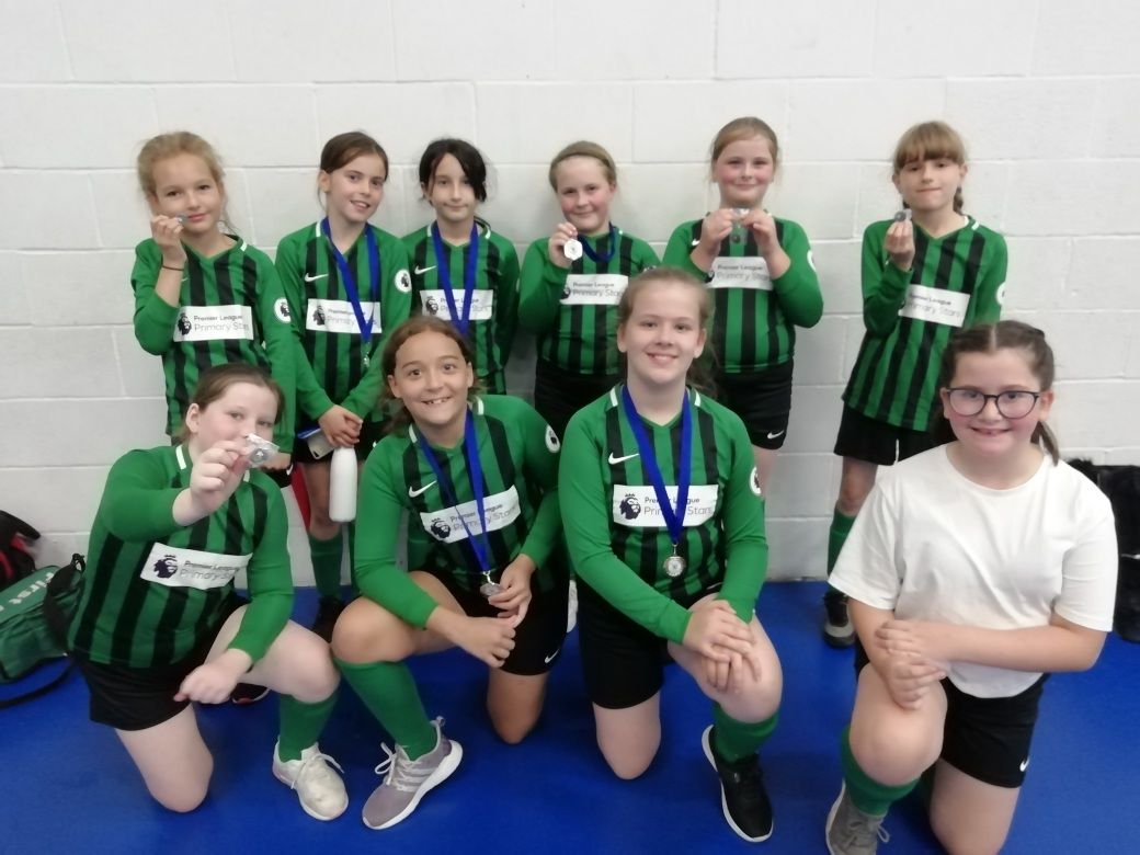 test Twitter Media - Y5/6 Girls football. Went really well. All the girls got stuck n and came home with rewards. Team A finished second with medals (all draws and 1 win) and Team B earned badges for respect (all draws and 1 loss). Thankyou Vijay. https://t.co/PsUfNLZv3q