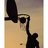 Silhouette of a man slam dunking a basketball posters normal