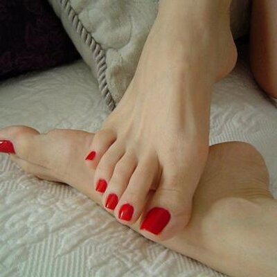 Blonde Kathy Sweet is giving a footjob to a foot fetishist  1354842