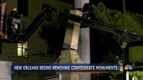 In helmets and tactical vests, New Orleans workers begin tearing down Confederate monuments. @gabegutierrez reports.
