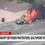 LIVE: A police car engulfed in flames. Live #BaltimoreRiots coverage: http://t.co/wJSgobnXF1 http://t.co/AimGSFmVtD http://t.co/WJ8lTwrHSd