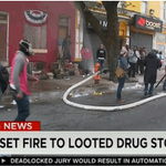 .@CNN live coverage shows a person using what appears to be a knife to cut FD water line near CVS in Baltimore http://t.co/9OciYYxp6R