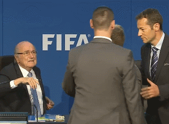 A protester just interrupted Sepp Blatter's FIFA presser by throwing (fake?) money all over the place. http://t.co/4IMnxebX3e