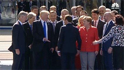 President Trump has more awkward handshakes at NATO summit