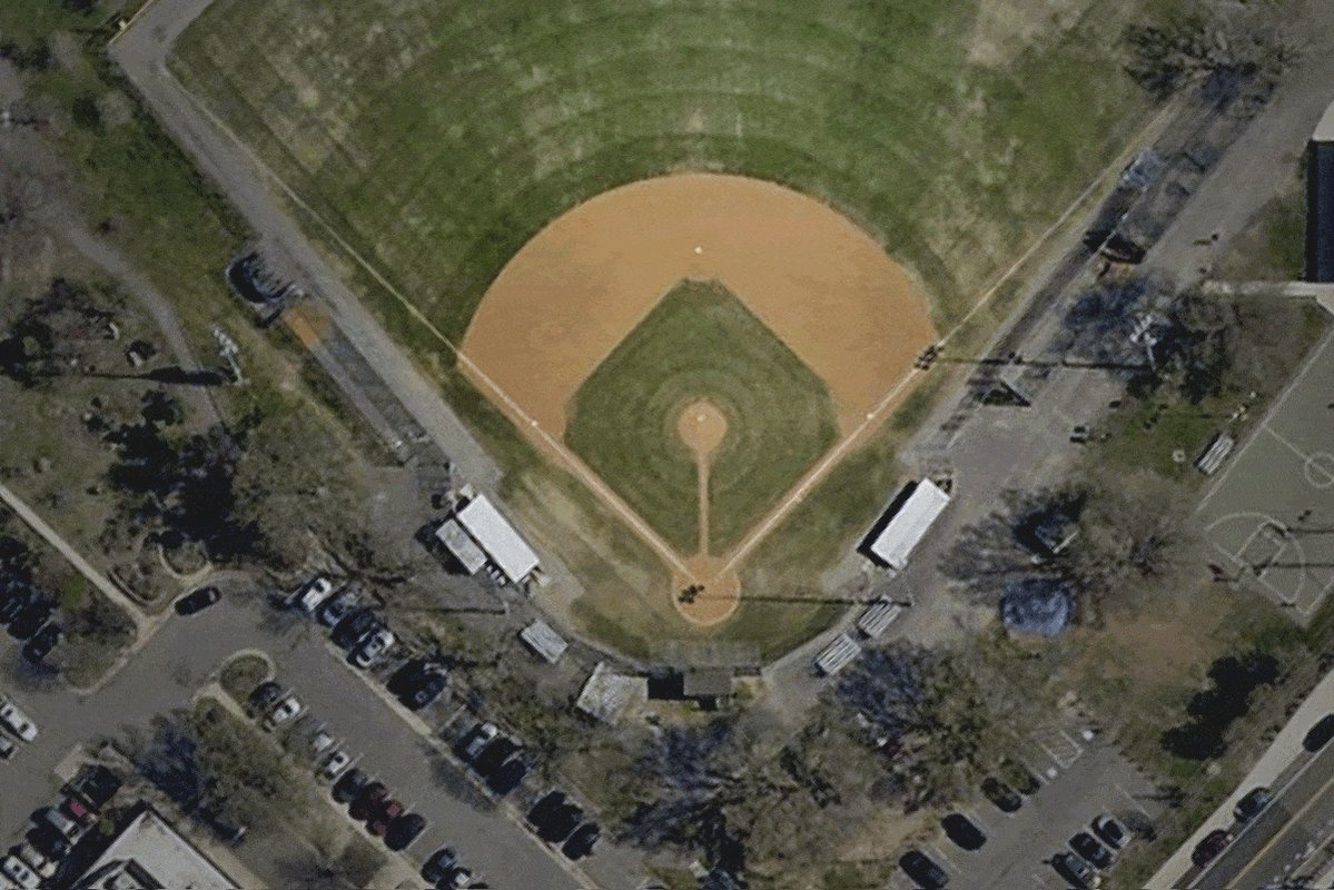 The baseball field shares a parking lot with a YMCA, where a bullet landed in a pool