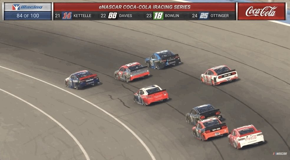 Three wide for the race lead!  It's all to play for with 15 laps to go at Auto Club:
