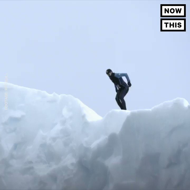 This pro cliff diver jumped off an iceberg into freezing