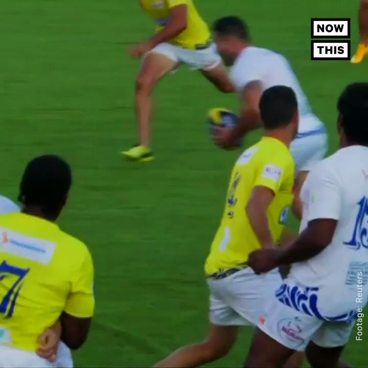 Rugby players jump into the water to score in this tournament